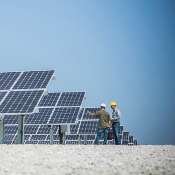 two Engineers inspecting solar panels